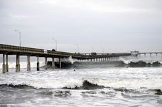 Large waves brush the bottom of the pier. San Diego, California.