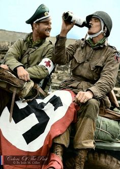 After being captured in Normandy on D-Day, Medic Lt. Briand N. Beaudin and 2nd Lt. Paul E. Lehman both of 3rd Battalion, 508th Parachute Infantry Regiment, 82nd Airborne Division celebrate their...