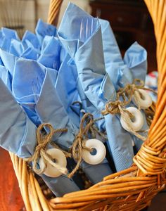 Napkin wrapped around silverware: what a cute way to organize the buffet table while incorporating your event theme