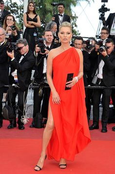 Cannes Film Festival 2016 Red Carpet. Kate Moss made a bold statement in a bright crimson Halston dress.