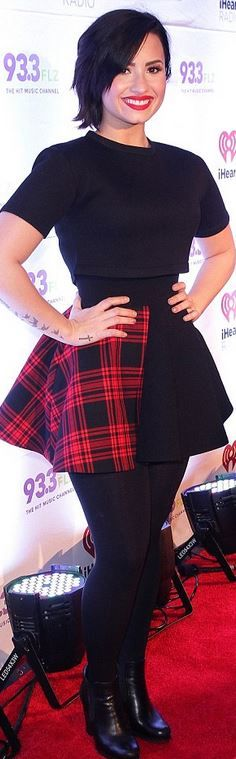 Who made Demi Lovato's black tee, red plaid skirt, and ankle boots? Shirt – Etre Cecile  Skirt – Fausto Puglisi  Shoes – Prada