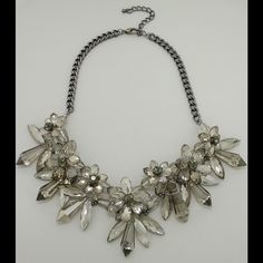 Anthropologie gray winter flowers acrylic necklace New just  perfect for any day or event no outfit. 16 inches long with lobster clasp and extender Anthropologie Jewelry Necklaces
