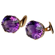 Antique Russian Amethyst Gold Cufflinks.  A pair of 14K gold cufflinks set with oval faceted amethysts (estimated total weight 25.70 ct)  made in the city of Kazan between 1908 and 1917  marked with maker's initials and 56 zolotnik standard  width 18 mm (3/4 in.)