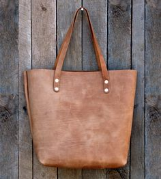 This handmade leather tote will age beautifully!