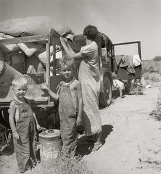 "August 1936. ""Part of an impoverished family of nine on a New Mexico highway. Depression refugees from Iowa. Left Iowa in 1932 because of father's ill health. Father an auto mechanic laborer, painter by trade, tubercular."