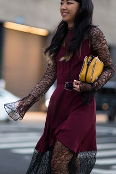 Street style from SS17 New York Fashion Week. Your style takeout? Give lace an edge and look for XXL sleeves to layer under dresses