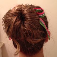 Messy bun with a bow.