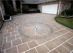 Super cool driveway - and it's all painted concrete!! Much more cost friendly than having it laid with pavers!