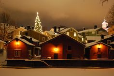 Red shore houses during Christmas time www.visitporvoo.fi
