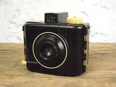 1940's Kodak Baby Brownie Special      This petite, bakelite camera is truly an art deco treat! Manufactured by Kodak from 1938-1954, this 127 film camera fits perfectly in the palm of your hand. This particular camera is in very good vintage condition - there is some light wear and one little chip to the bakelite on the bottom (see last photo) but I don't believe it would cause light leaks. This Baby Brownie has not been film-tested, but the shutter snaps when the lever is pressed.