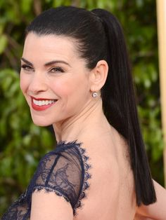 Famous Actress Julianna Margulies with her fancy-high-ponytail hairdo.