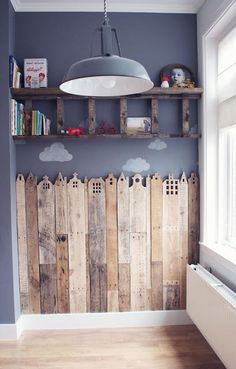 kids room. love the ladder shelf but even more so love the pallet city scape.  would be great behind boys beds for superhero room