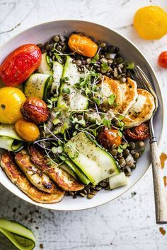 A fresh, summery lentil salad topped with fried halloumi, roasted tomatoes and zucchini | thealmondeater.com