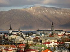 Can you imagine waking up and seeing this outside every day?  Love the colourful rooftops, too!  (Iceland, again!)