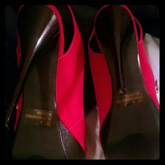 Pink and black booties Nwot. Bought at Body Central  and never wore them. 5 1/2 stiletto heel with a 1 inch platform. Zip on sides for easy fitting. Qupid Shoes