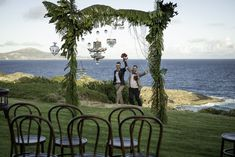 Elegant beach wedding, Green and crystal arbour with chandelier, bouquet red roses. Christmas Wedding Decorations, Beach Wedding Decorations, Fall Wedding Dresses, Elegant Wedding Dress, Blue Wedding Centerpieces, Best Wedding Colors, Vintage Wedding Flowers, Bridal Table, Outdoor Wedding Reception