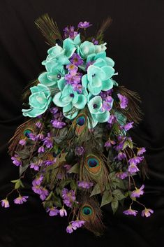 Peacock feathers!!! Peacock feathers are are stunningly beautiful and quickly becoming very popular in the wedding world!! This beautiful wedding bouquet is sure to leave your guests in awe! The bride                                                                                                                                                                                 More