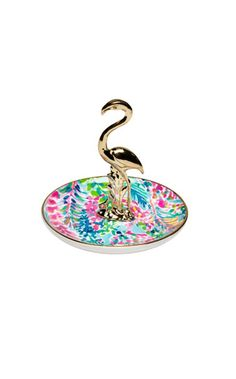 This ring holder features one of our favorite prints and contains a gold critter to store your rings.