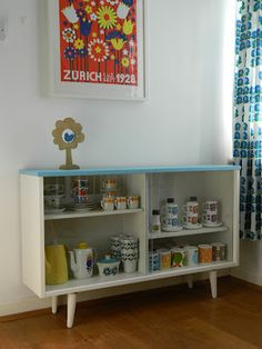 70's dark wood cabinet with a facelift - so cute, and I like the vintage dishes too!