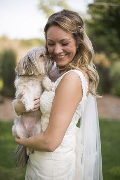 The bride and her playful pup!  Photo by Ashley B.  #weddingphotographersmn #minneapolisweddingphotography