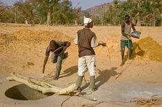https://flic.kr/p/8P5m2J | Yaya foot action pulling up bucket by Judy Saye Kopanic | The Dogon villagers do all the hand labor of well digging. The well master places the metal to mold the concrete that lines the walls. Many villagers help on a rotating basis. Young boys lead the donkey cart that carries gravel to strengthen the concrete. Both boys and girls haul water. The men take turns digging, so it becomes a game, each one showing his mettle while the others lounge about and tell ...
