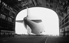 The German-built zeppelin Hindenburg is shown from behind, with the Swastika symbol on its tail wing, as the dirigible is partially enclosed by its hangar at the U.S. Navy Air Station in Lakehurst, New Jersey, May 9, 1936. (AP Photo)