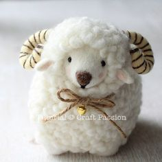 Tutorial with very detailed instructions on how to make needle felted sheep, Ramie. Ramie has a beautiful thick wool coat, big brown nose and rosy cheeks.