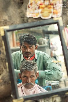 The street barber giving a head massage.