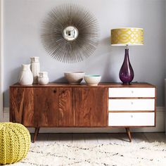 Grey carpetted living room with retro sideboard
