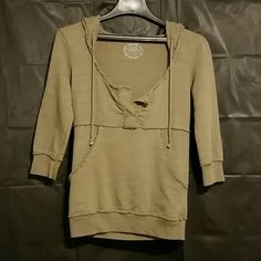 Free People Army green pull-over sweater.  Says medium but fits more like a small.  100% cotton.  Pic4 shows color the best. Free People Sweaters