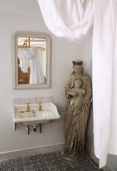 At Berdoulat & Breakfast in Bath, a venture from designer Patrick Williams, an antique Virgin and Child statue is seen indoors—this time in one of the room's bathrooms. #remodelista #bathroom #interiordesign #art