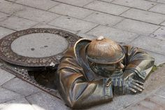 "manhole ,bratislava slovakia - the many statues signify that the communist party was ""always watching"" The Good Soldier Svejk, Danube River Cruise, European River Cruises, Visit Budapest, Street Art Utopia, Bratislava Slovakia, Holiday Places, Frozen In Time, Eastern Europe"