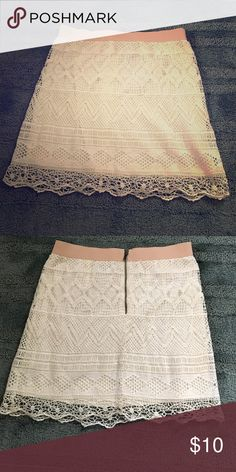 AE white lace skirt in size 2. Dress it up with heels and a bright skirt or down with flats and denim! Beautiful chic and sleek white and cream / ivory lace skirt with nude waist band in mid thigh length from American Eagle in size 2, NWOT in perfect condition. American Eagle Outfitters Skirts Mini