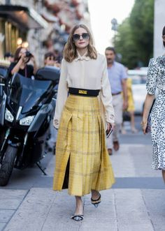 Olivia Palermo wearing a white blouse golden Fendi skirt heels blue sunglasses outside Fendi during Paris Fashion Week Haute Couture Fall/Winter...