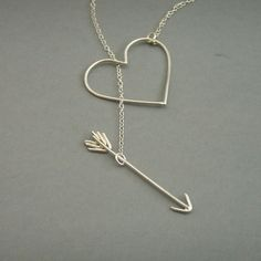 Heart with an arrow through it. Cute necklace :)