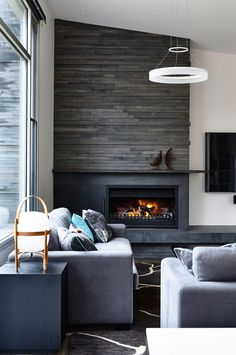 Like the fireplace and the material surrounding it - wood, tile?