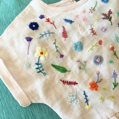 I gave my 2 year old niece her stitched dress a little while ago, but in true toddler fashion she refused to try it on for… Embroidery Designs, Hand Embroidery Stitches, Ribbon Embroidery, Embroidery Art, Cross Stitch Embroidery, Embroidery On Clothes, Embroidered Clothes, Embroidered Flowers, Diy Broderie