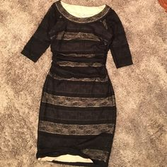 Sangria Lace Dress Like new! Worn once. A stunning Sangria dress. Double lining, Black/Nude Lace 3/4 sleeve. Bunches at waist for more slimming look. Size 4 shell: 96% polyester 4% spandex lining: 100% polyester Sangria Dresses