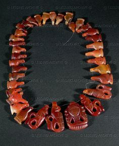 Carnelian necklace, From a tomb at Beth-Shan. Late Bronze/Early Iron Age   Rockefeller Museum(IDAM), Jerusalem, Israel