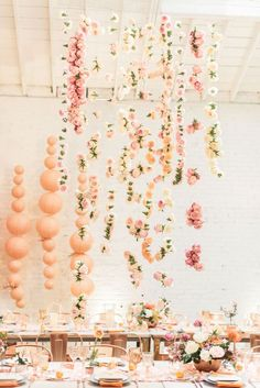 Cascading floral installation at spring dinner party