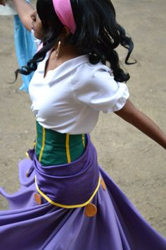 An Esmeralda cosplay! :D It looks like the sewing for this outfit is top-notch, and the girl wearing it is has the prefect shade of skin (I doubt that's make-up, but if so Good Job!) she also did a fantastic job on the hair-style, and whoever took this photo must have good timing... Gush-gush-gush. Yes, I really like this shot, and this cosplay. <3