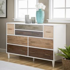 Taking inspiration from the designs of the mid-century, this eight-drawer dresser is ideal for those who favor shabby chic. With hints of Bohemian influence, each of the drawer fronts is finished with grey and oak-front veneers, creating a patchwork effect, accentuated by the white frame. The whole piece is constructed