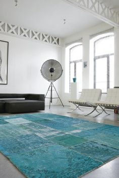 Swatches of various antique Turkish carpets are decolourized, redyed and sewn together to create a thoroughly modern, but decidedly bohemian patchwork.