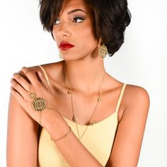 WANDERLUST Filigree Hand Chain | Gold  Inspired by all of the beautiful filigree we found on one of our Wanderlust adventures to Europe, the gold Wanderlust hand chain feature cascading circles of ornate filigree cutouts blended with a double strand bracelet.    Sure to make a statement, this bohemian style bracelet-ring hand chain is the perfect accessory for everyday elegance or wherever your wanderlust takes you. Slave Bracelet, Ring Bracelet, Bracelets, Hand Jewelry, Jewlery, Hand Chain, Strand Bracelet, Bohemian Style, Filigree