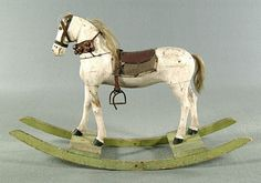 large painted and carved wood rocking horse, fabric seat, tail, mane and bridle with bells, green-painted wooden rockers
