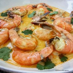 Slow Cooker Coconut Cilantro Shrimp Curry: 1 lb shrimp (with shells), 30 oz light coconut milk, 15 oz water, 1/2 C Thai red curry sauce, 2 1/2 tsp lemon garlic seasoning, 1/4 C cilantro