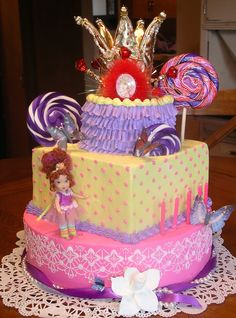 Fancy Nancy cake - BC on all layers w/stenciling on bottom. Used purchased crown, doll and lollipops.