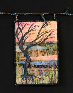 An Afternoon in Autumn by Eileen Williams.  Small art quilt hanging from painted tree branch.