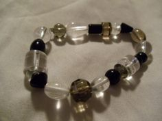 cute clear and black beaded stretch bracelet. Starting at $1 on Tophatter.com!