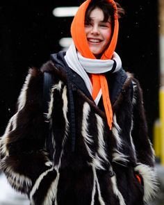 New Yorkers bundled up for a snowy start to NYFW. Statement pieces like oversized fur coats and bold scarves were popular choices.